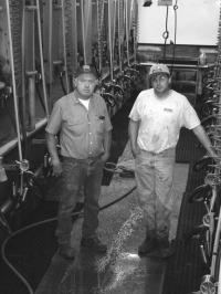 (L to R): Jim Danyow and Son Brett at family farm milking parlor on Walker Road in Ferrisburgh.