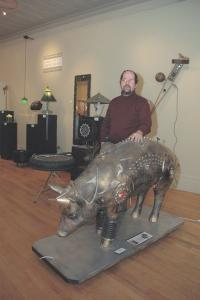 """David Martin stands by his creation """"CyBOARg"""". This along with his other sculptures are now showing at the """"UnEarth"""" exhibit at the Brandon Artists Guild on Center St.  in Brandon through April 28th."""
