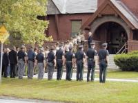 Members of The Vermont State Police, Addison County Sheriff's Department and Middlebury Police Department snap to attention outside the Middlebury United Methodist Church on Thursday morning 9-7-06 as they honor the late Wayne Heath. Heath served the state as a career state trooper and most recently as a Addison County Side Judge. He was preparing to run for a 4th term on the bench.