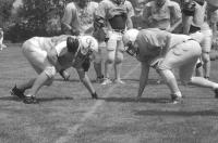 Middlebury's Robbie Harrison (right) works out with the linemen in 90 degree temps on Friday moring in Plymouth NH.