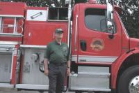 Ryegate Vermont Fire Chief Gene Perkins stands next to a METALFAB fire engine during an exhibition of fire and safety equipment at Middlebury College.  The Chief is also a METALFAB factory rep for K & T Fire Equipment Sales and Service (Fire Apparatus Sales) in the State of Maine and Vermont.   A score of exhibitors attended the 2007 Vermont State Firefighters Convention held in Middlebury and hosted by The Addison County Firefighters Association.  Exhibitors were impressed with the hospitality offered by Middlebury College and the Middlebury Community.