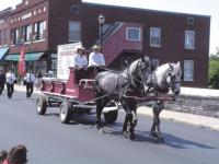 The Addison County Firefighters Association horse drawn wagon leads this years parade for The Vermont State Fightfighters Convention.
