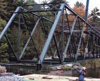 100-year-old bridge returns after being restored.