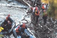 Members of the Vermont State Police Search and Rescue team along with members of the Colchester Technical Rescue Team prepare to recover the body of Nicholas Garza from beneath floating debris in Otter Creek on Tuesday evening May 27th, 2008. Middlebury Police have led the investigation and search efforts into Nicholas Garza's disappearance. The Garza case remains under investigation.