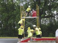 """This skill and team shaping drill can be traced back hundreds of years, perhaps thousands. The """"bucket brigade"""" still works and builds team spirit. This exercise was part of the competition during the ACFFA Muster June 18, 2011 at VUHS."""