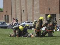 """Firemen drag a """"victim"""" during a skills exercise at ACFFA Muster on Saturday June 18, 2011. VUHS was the site of this year's event and was well attended."""