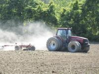 """A soggy spring has put the farmers behind in planting their crops. Mierop's Farm in Bristol, pictured above, are working the soil in anticipation of planting. The warm weather is a welcome sight for farmers during """"Spring's"""" work."""