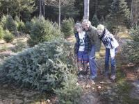 Erik, Rich and Paige Stolen finding the perfect tree at Zeno's Tree Farm.