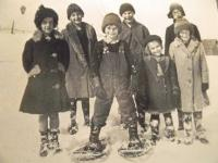 Standing in the front of the Porterboro School in Ferrisburgh, the students including Isabel pause for a moment in their day at the one room school in 1928. Shown from left to right are : Lilian (Husk) Birkett, Evelyn ( Husk) Cushman, Clement Sears, Chester Bradford, Frances ( Husk) O'Connor, Florence( Husk ) Hawkins, and Isabel ( Husk) Munnett. Pleased as punch with her penmanship later on in life, her teacher Miss Julia Thorpe encouraged her to practice and Isabel had to take penmanship in college in order to get her teaching degree.