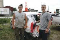 "The Hastings brothers (LtoR) Marshall and Jonas prepare for the 2012 Demolition Derby at Addison County Fair & Field Days. The ""demo"" car used to be Marshall's. The brothers were confident that they would do well."
