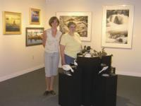 Sue Potter of the Lake Dunmore Fern Lake Association and Edgewater Gallery manager Bay Jackson pause in the midst of the new show titled On the Water that will run at the gallery from August 18th-August 26th featuring the works of artists that call Lake Dunmore and Fern Lake home.