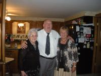 Seen here with Rita Armell and Gisele Sabourin at a 2011 wedding, Greg officiated for granddaughter Michelle, it is easy to see his love of people and humor
