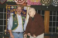 Doctor Ray Collins receives his 60 year pin from King Lion Roger Desabrais Jr. at a recent Middlebury Lion's Club ceremony.