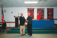 Bill LaBerge receives his Lions pin for 35 years of service from King Lion Roger Desabrais Jr.