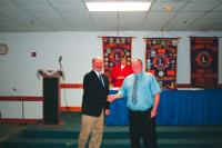 Greg Wry receives his Lions pin for 