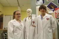 Yvette Blair and Kyle Korda both Juniors in Instructor Rita Wells Rn MSN class take time for a quick picture with Mr. Bones before greeting firends, parents and visitors to the annual Open House evening at the  Hannaford Career Center on Thursday, February 7, 2013. Yvette and Kyle are part of a growing number of students throughout the  country who are studying for a career in health care while still in high school and Hannaford offers them excellent opportunities to do so. Health professions is now a full day program at the school providing even more experience and hands on knowledge for the students enrolled.