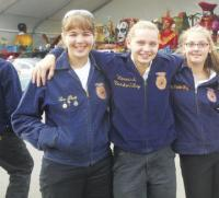During the 2012 Big E parade Abbie Stearns, Jenna Rao, Mikayla VanderWey pause to enjoy the moment.