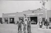 Standing between the two original owners of Person & Foster Motors, six year old  Ed Foster stands in front of what today is Foster Motors and represents over forty years of his life's work.