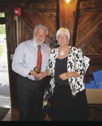Incoming Rotary President Tony Panella thanks out going Rotary president Sue Burdick
