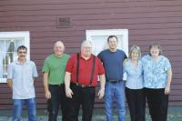 Standing together in front of the barn that continues to serve Addison County and the Champlain Valley's furniture needs are Scott Delorme, Shawn Thomas, Bub Crosby, new owner Peter Stevens, Belinda Curler and Meg Crosby. The deal is official and starting October 1st, Bub's Barn became Big Barn Home Center!