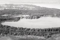 This aerial photo by Robert Lyons was a favorite of Wally as it shows the home he and Betty built with family and love. It also shows Lake Champlain and the environment which was a passion for Wally and a life long project to create technology that would help people manage their use of the the land and the water.