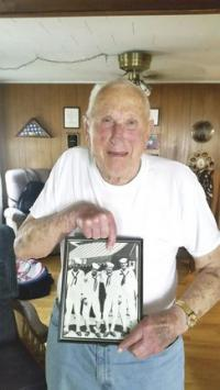 Proud of his service to his nation, George shows the image of himself serving in WWII.