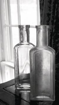 Two of the empty bottles of Dr. Ingham's famous elixir that was made on the property for over thirty years.