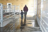 Father & son looking to the future of robotic milking.