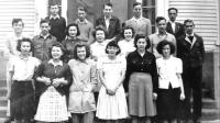 Standing with the rest of his class in 1946, Olin Flynn remembers most the music, the sports and the friendships of his time in high school.